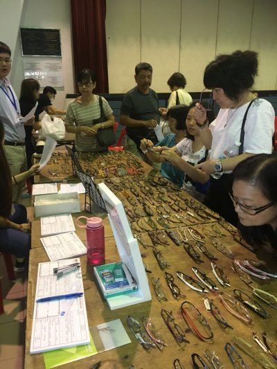 Residents selecting their frames to make a pair of glasses during the eye screening conducted at Choa Chu Kang Community Centre on 8 October 2017.